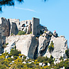 Rocky Ruins Photo: Mountain castle ruins framed by trees in Les Baux de Provence.