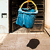 photo: Drop Delivery - A hanging basket lowered from an apartment window.